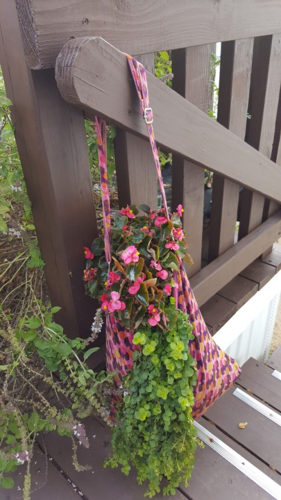 Hanging Purse With Flowering Plant In It