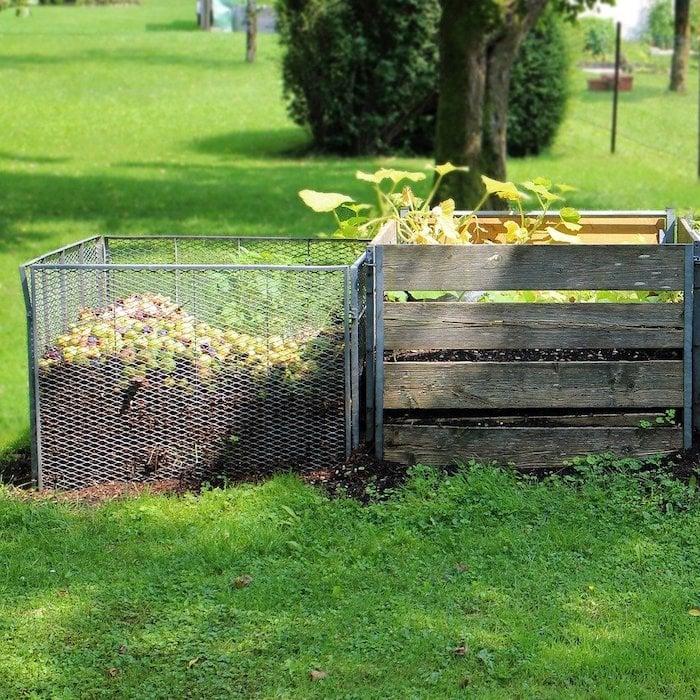 compost bins in a field